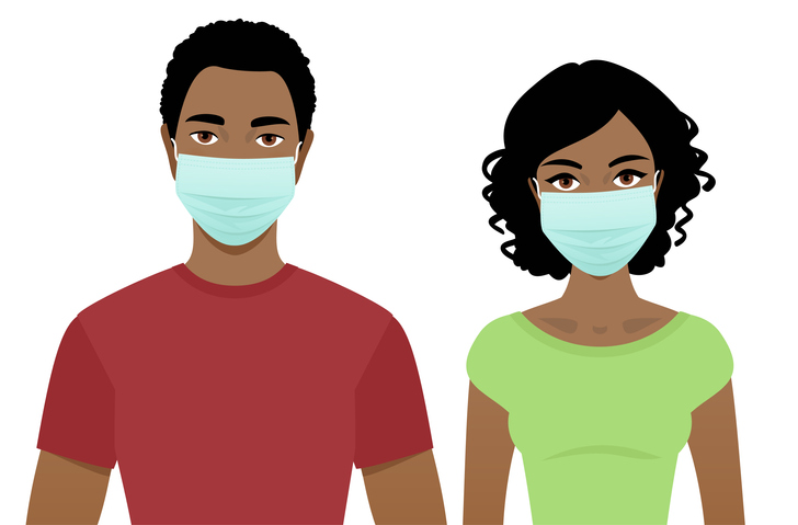 Young man and woman in surgical masks