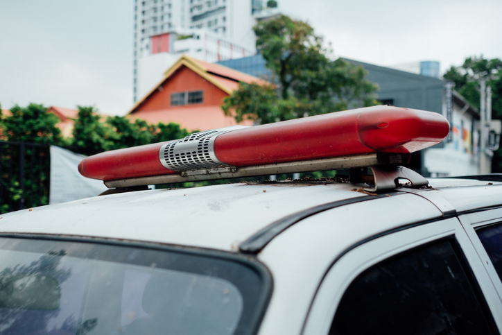 Close-Up Of Police Car Siren Against Building In City