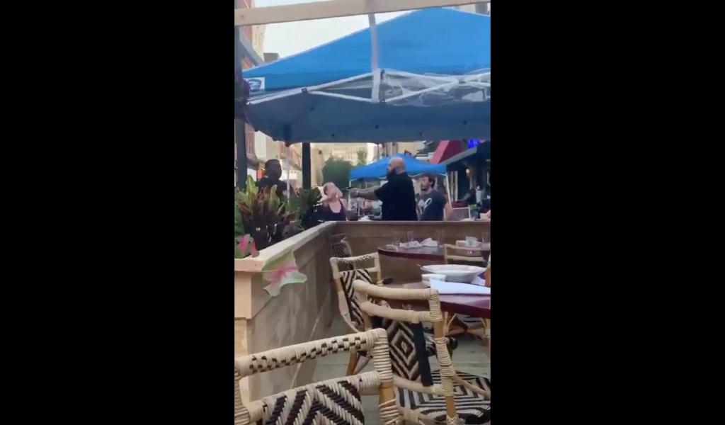 Philly bar owner pulling gun on Black man