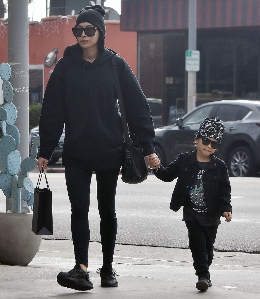 6/01/2020 : Actress Naya Rivera pictured as she holds hands with her son Josey Hollis Dorsey while out for a stroll in Los Angeles, CA, USA.