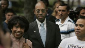 (Irvine)–Dr. Michael Drake (center) and wife Brenda (left) arrive for a greeing in Aldrich Park wit