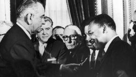 LBJ hands pen to MLK