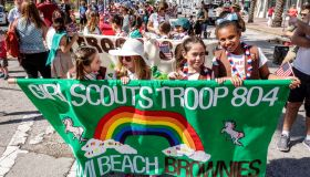Miami Beach, Veterans Day Parade, Brownies Girl Scouts troop marching with banner