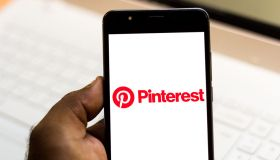 In this photo illustration the Pinterest logo is seen...