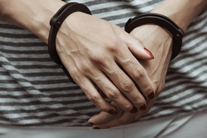 Woman arrested wearing handcuffs