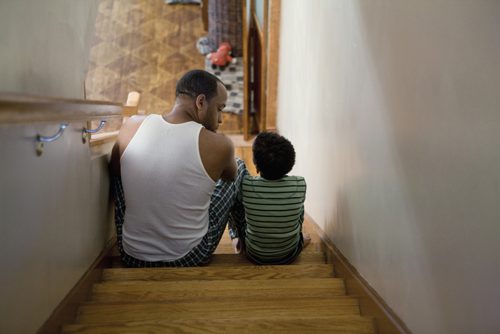 Father sitting with son on the stairs