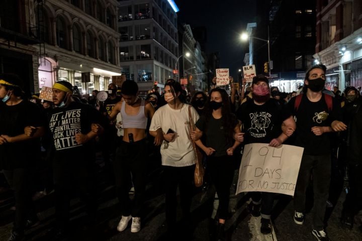 Hundreds of people protest on streets in New York after...