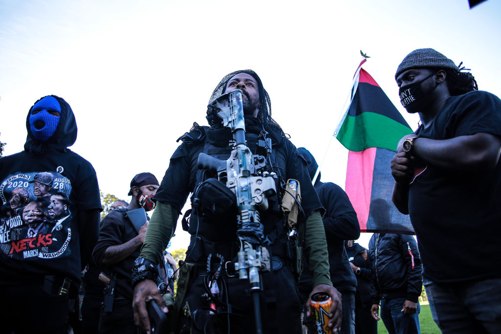 Members of the Black Rider Liberation Party are seen wearing...