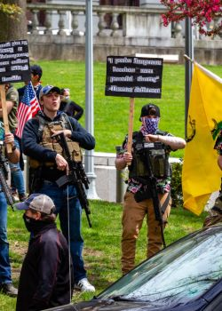 Armed protesters stand in front of the Pennsylvania State...