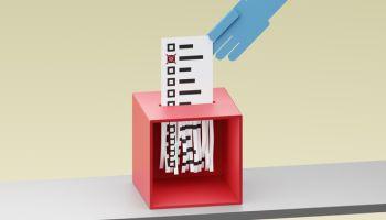 Ballot being shreddered inside a ballot box