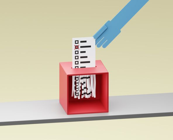 Ballot being shreddered inside a ballot box