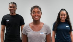 """Smiling young adults wear """"I voted"""" stickers"""