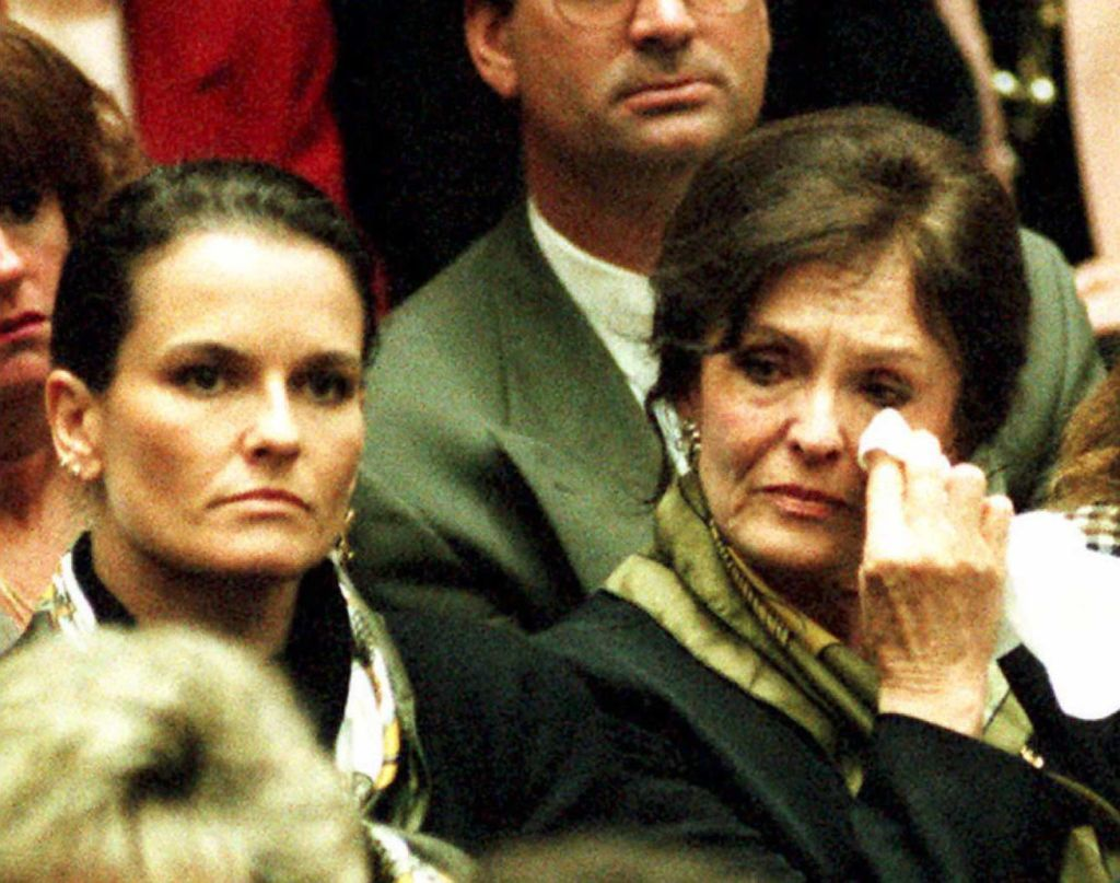 Mother Juditha Brown (R) wipes tears from her eyes