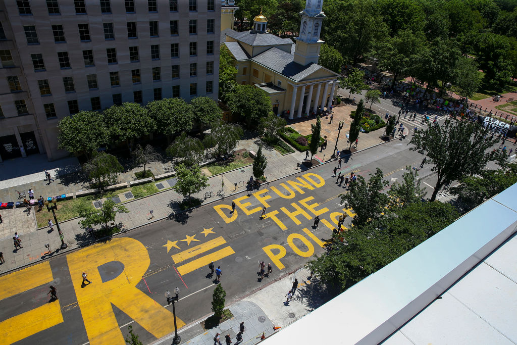 """Protestors Add """"Defund The Police"""" Messaging To Washington DC Street"""