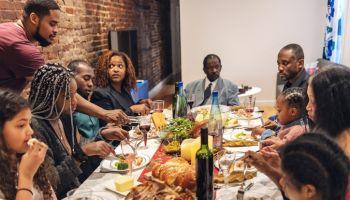 Multi-generation ethnic family having Thanksgiving dinner