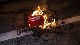 Black Lives Matter protesters burn a Trump Train hat prior...