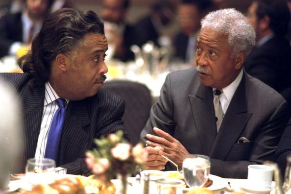The Rev. Al Sharpton (left) confers with former Mayor David