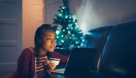 Woman online buying Christmas gifts