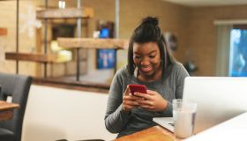 African American Generation Z Female Getting News on College Funding at Home