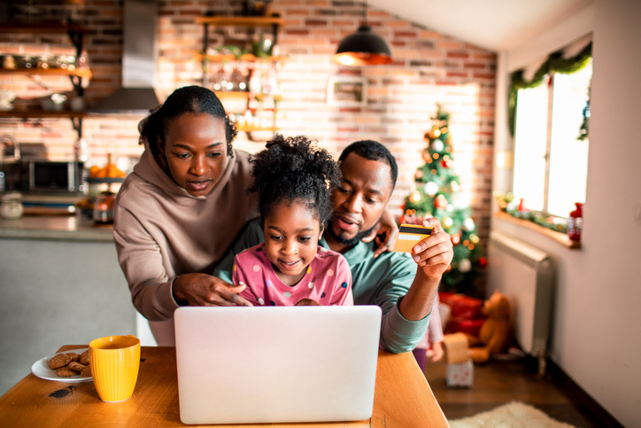 Young family online Christmas shopping