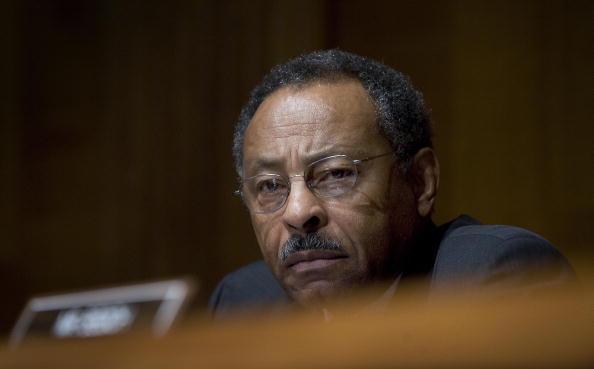 US Senator Roland Burris, D-Il, listens