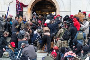 Rioters clash with police trying to enter Capitol building...