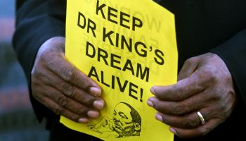 DIGITAL IMAGE SHOT ON 01/15 /2001–A marcher holds a piece of paper remembering Martin Luther King Jr