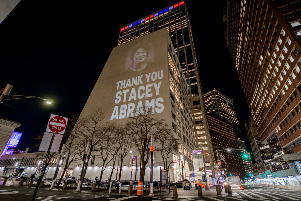 Activists with Rainforest Action Network and The Illuminator...