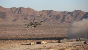 A CH-53E Sea Stallion Helicopter flies in for a simulated medical evacuation during the Tank Mechanized Assault Course aboard Marine Corps Air Ground Combat Center Twenty-nine Palms, California. Dated 2014.