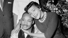 Dr. Martin Luther King and his wife, Coretta, are smiling an