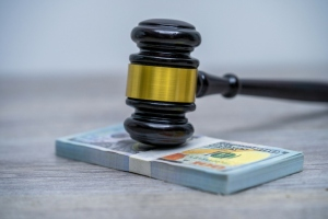 Judge's hammer gavel and bank note.Representation of corruption and bribery in the judiciary.