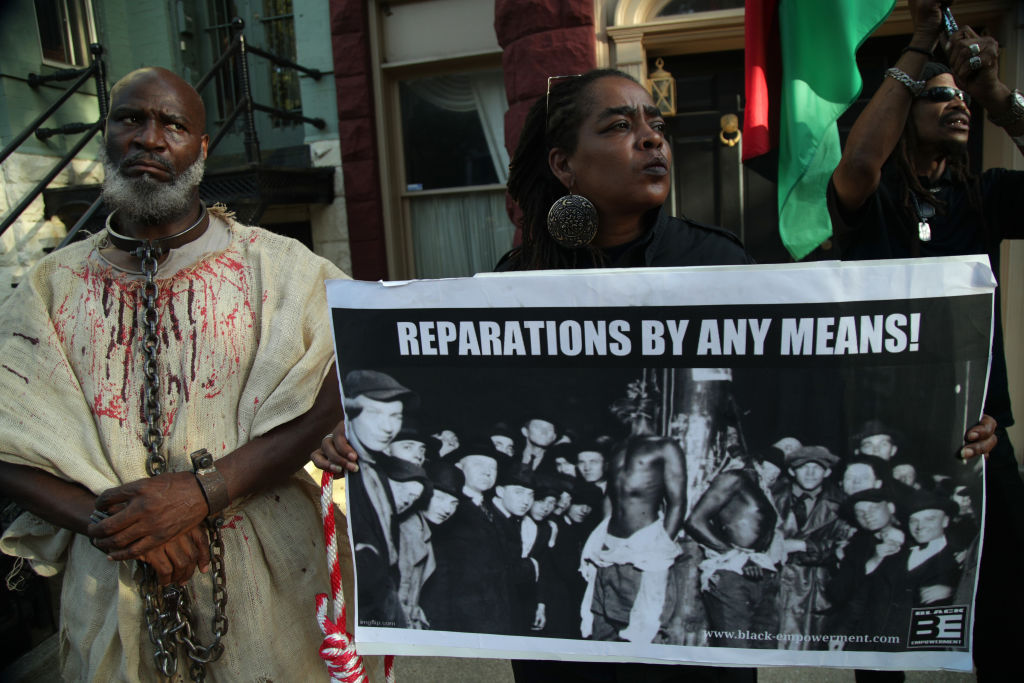 Activist Groups Protest Against Senate Majority Leader McConnell On National Reparations Day