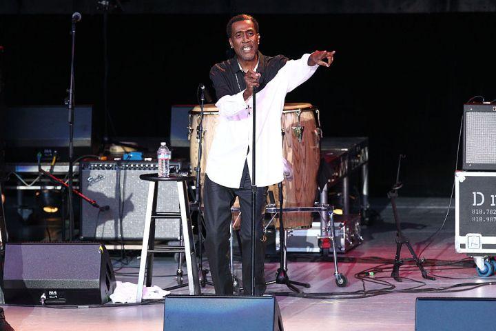 Reggie Warren, singer, 52