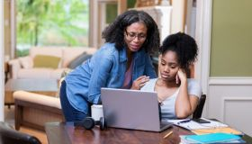 Mature mom comforts upset daughter