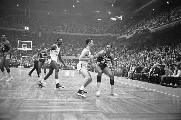 Elgin Baylor Battling Bob Cousy