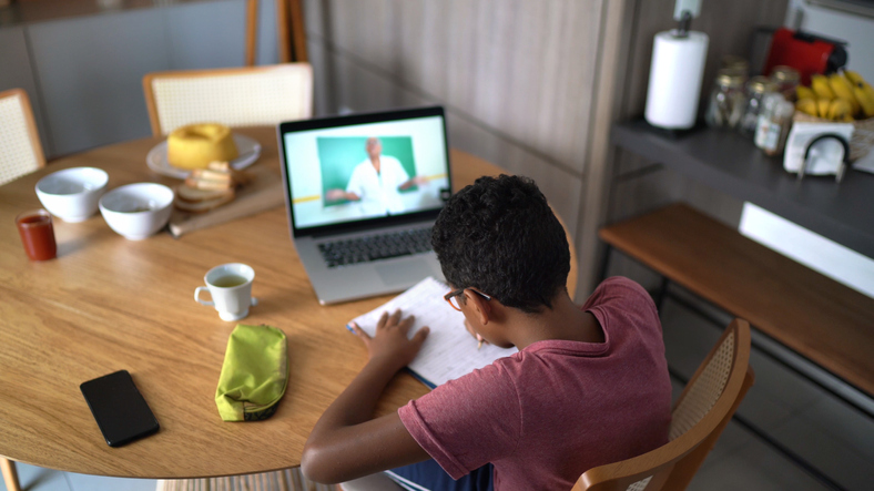 Boy watching video class at home