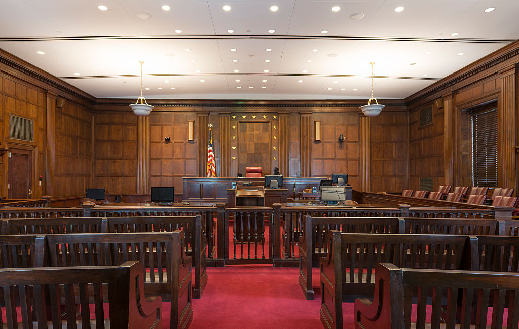 Courtroom. The Robert S. Vance Federal Building and U.S. Courthouse is a four story white marble bui
