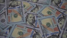 Lots of US Dollar bank notes as for financial business background.