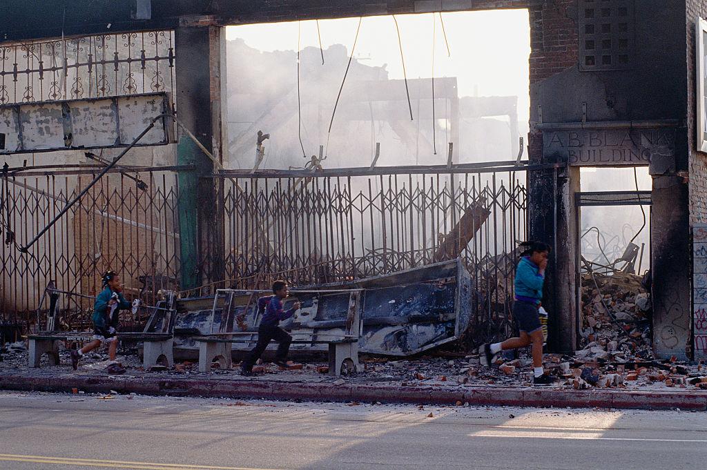 Children Passing Destroyed Building