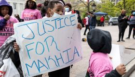 A child holds a placards that says Justice for MaKhia...
