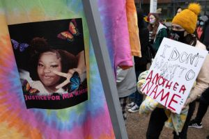 Black Lives Matter activist holds a placard during the Ma...