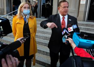 Mark and Patricia McCloskey arrive for court