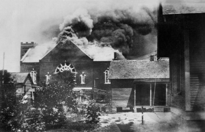 Burning of Church where Ammunition was stored during Race Riot, Tulsa, Oklahoma, USA, American National Red Cross Photograph Collection, June 1921