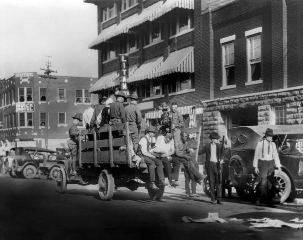 Truck on Street near Litan Hotel carrying Soldiers and African Americans during Race Riots, Tulsa, Oklahoma, USA, Alvin C. Krupnick Co., June 1921