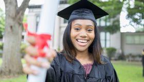 Confident female college graduate