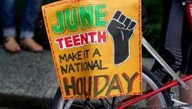 WASHINGTON,DC-JUNE19: Demonstrators take a knee for 8 minutes a
