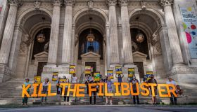 Protesters seen holding a banner reading KILL THE FILIBUSTER...