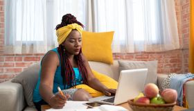 Afro woman working from home