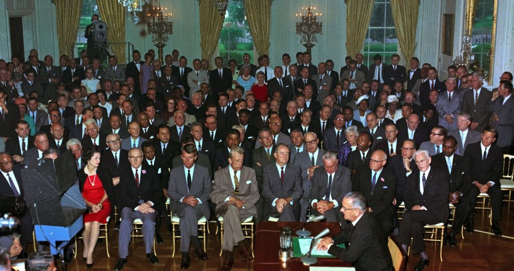 The Civil Rights Act of being enacted by President Lyndon Johnson, July 2, 1964.