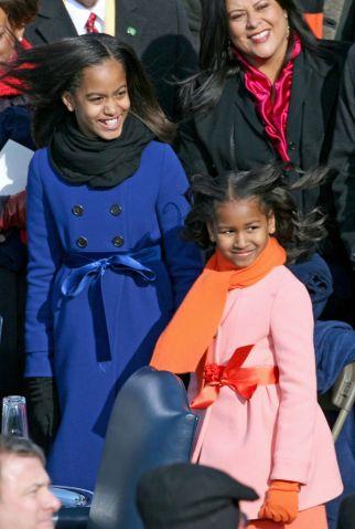 (012009 Washington, DC) Malia, 10, and Sasha Obama, 7, wait for their dad to enter for his inauguration, Tuesday, January 20, 2009. Photo by Angela Rowlings.